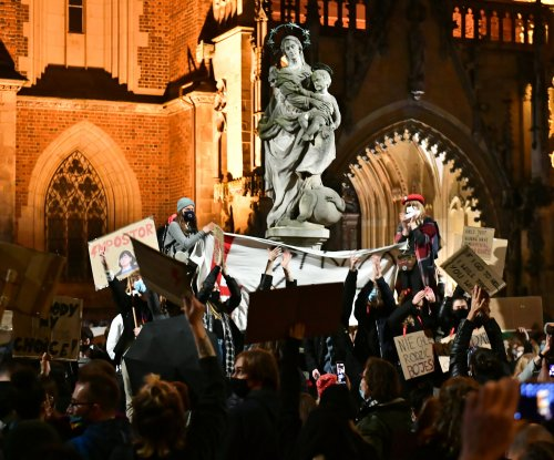 Polish protesters block roads, storm churches over abortion ban