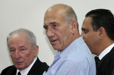 Ex-Israeli PM Olmert charged with bribery