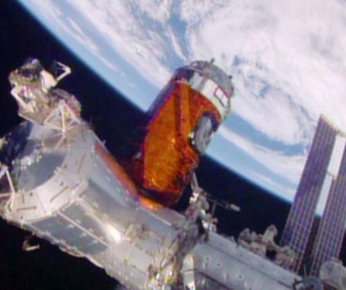 Japan's cargo craft delivers supplies, whiskey to space station