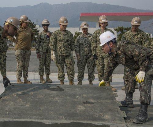 South Korea says North Korea bluffing on mini warhead claims