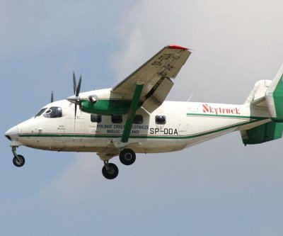 Indonesia police aircraft carrying at least 12 crashed in sea