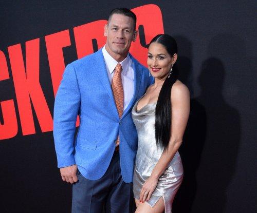 John Cena, Nikki Bella cozy up at 'Blockers' premiere