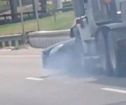 Semi truck drags car for more than a mile on highway