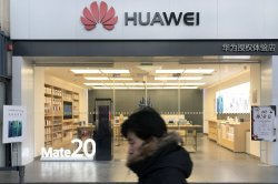 Britain bans telecoms from installing Huawei equipment
