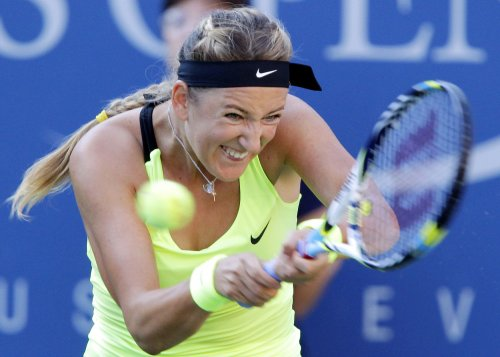 Azarenka through to third round in Beijing