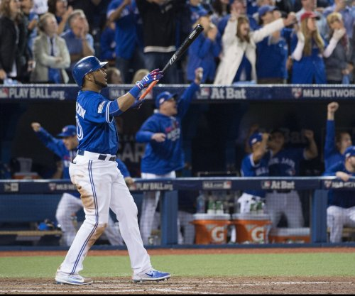 Edwin Encarnacion blasts Toronto Blue Jays to 11-inning, wild-card win