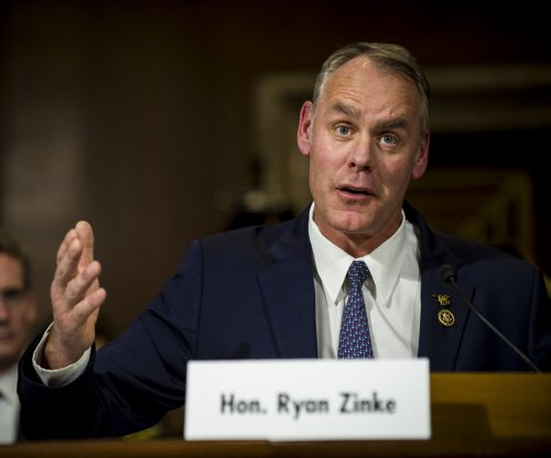 Zinke expresses some difference from Trump on climate change, Russia