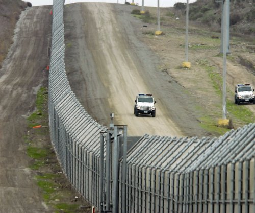 California sues Trump over border wall plans