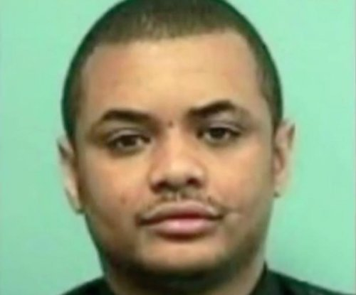 Baltimore detective shot in head dies, police search for killer