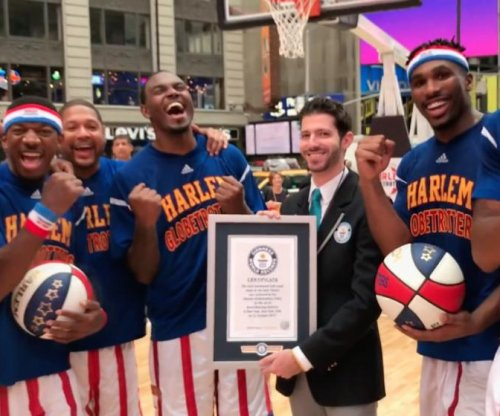 Harlem Globetrotters make world-record 348 half court shots in one hour