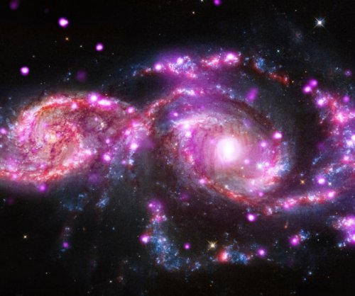 Grazing galaxies offer cosmic holiday light show