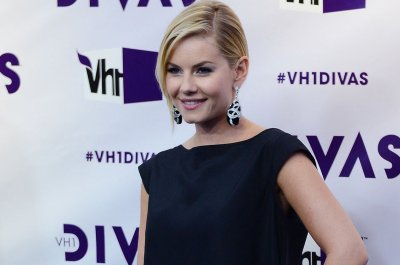 Elisha Cuthbert gets apology from network after she threatens to sue over tweet
