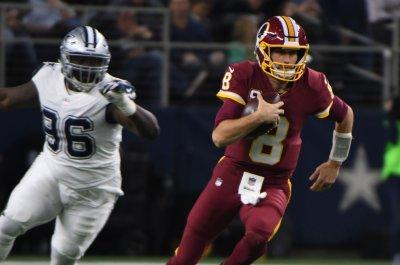 Denver Broncos' Vance Joseph treading carefully on talk of Kirk Cousins