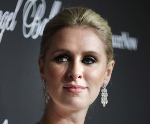 Nicky Hilton bares butt cheeks in bizarre dress