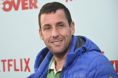 Adam Sandler picks up guitar with Jimmy Fallon for Garth Brooks parody