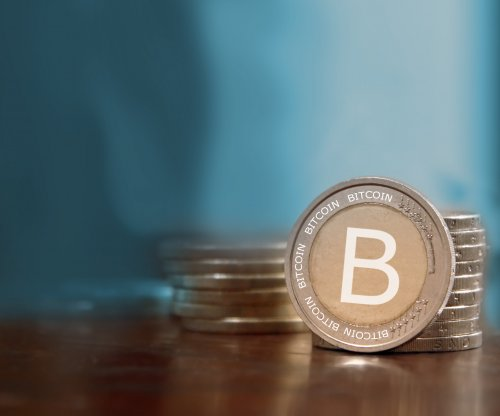 Bitcoin hits record $1,206 per coin