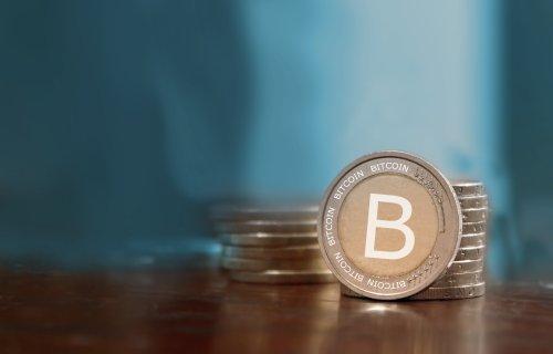 Bitcoin hits record $1,206 per coin