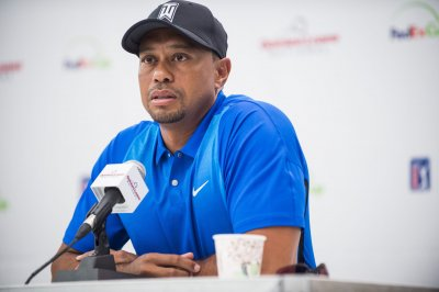 Tiger Woods struggles in Dubai Desert Classic first round