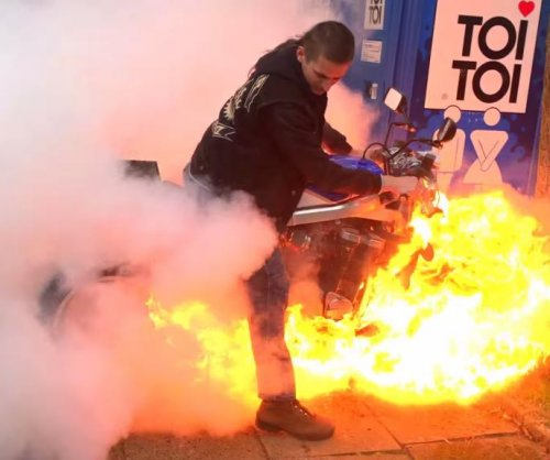 Motorcycle bursts into flames during burnout attempt