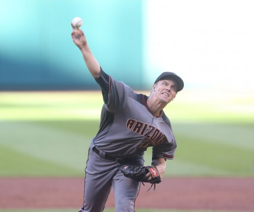 Zack Greinke pitches Arizona Diamondbacks past slumping Houston Astros