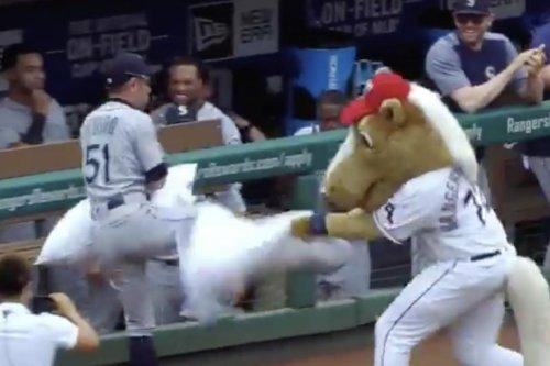 Ichiro has pillow fight with Texas Rangers' horse mascot