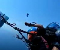 Paraglider's lost sunglasses land in her lap in midair