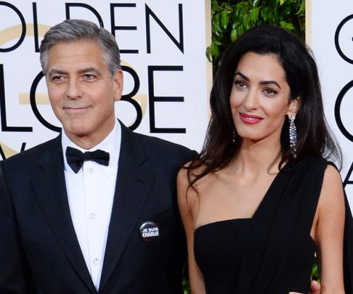 George and Amal Clooney spotted at dinner with her parents