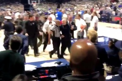 Mick Cronin: Cincinnati basketball coach, tries to confront Xavier player, pulled off court