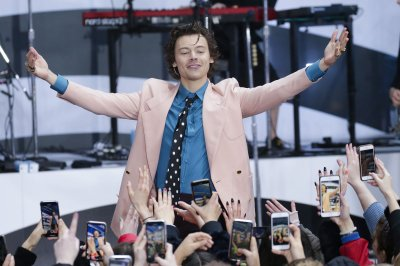 Harry Styles discusses the 'joy' he finds in dressing up