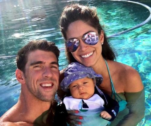 Michael Phelps' baby boy Boomer turns heads during Summer Olympics