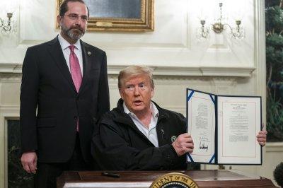 Trump signs $8.3B bill to fund COVID-19 fight, will visit CDC