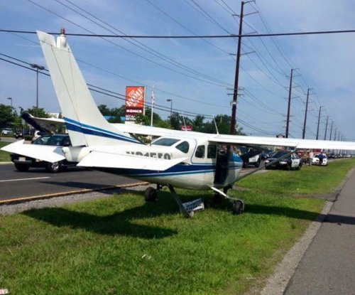 Video captures plane's emergency landing on highway median