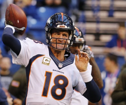 Broncos' Peyton Manning, DeMarcus Ware not making trip to Chicago
