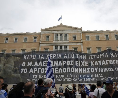 Greek PM fends off no-confidence vote, opposition protests continue