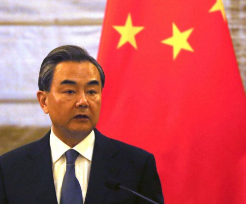 Chinese foreign minister calls Philippines case 'farce' ahead of court ruling