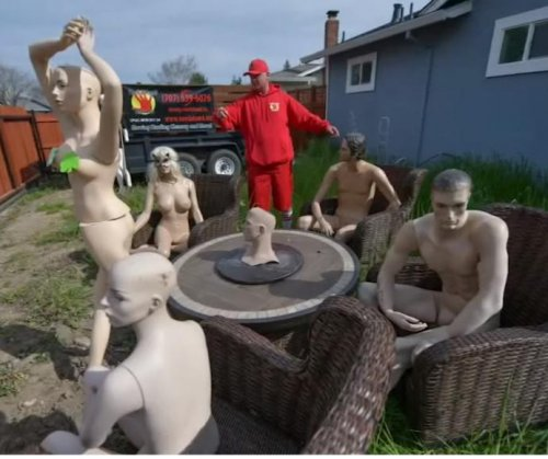 Man forced to shorten fence gets even with nude mannequins