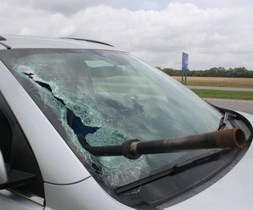 Metal pole crashes through windshield on the highway