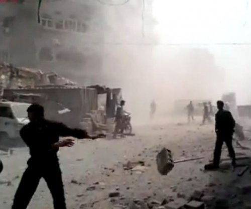 At least 80 killed by Syrian government airstrike in rebel-held Douma