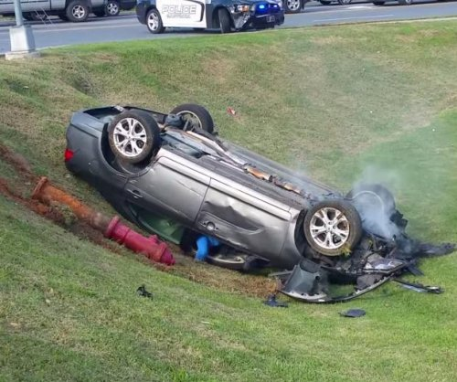 Woman does donuts at intersection, flips car, IDs herself as 'faith, hope and love'