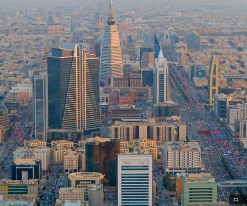 Saudi Arabia cuts government workers' pay for first time