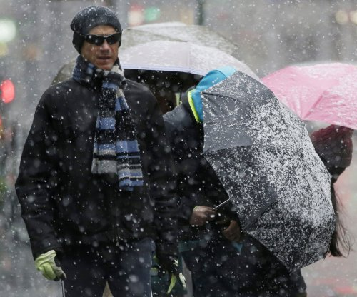 N.Y. snow blamed for 3 deaths; nor'easter skips Boston