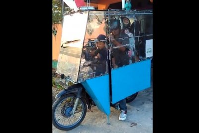 Watch:-Motorcycle-converted-into-enclosed-family-vehicle