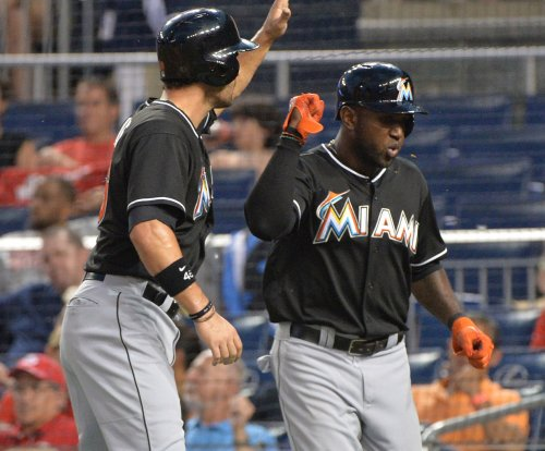 Martin Prado, Marcell Ozuna help Miami Marlins hold off Philadelphia Phillies