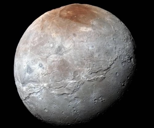 NASA offers new, more colorful look at Pluto's moon Charon