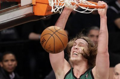 Boston Celtics rout New York Knicks to remain in first place