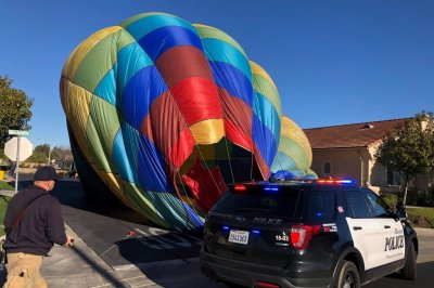 Hot air balloon makes lucky landing in neighborhood
