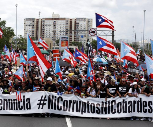 200,000 protesters march in San Juan; cruise ship impact nears $2.5M