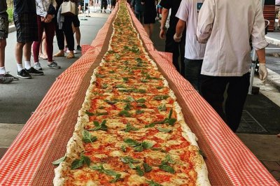 Pizzeria cooks 340-foot pizza to raise money for Australian firefighters
