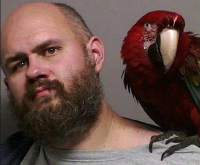 Parrot brought to court appears in Oregon owner's booking photo