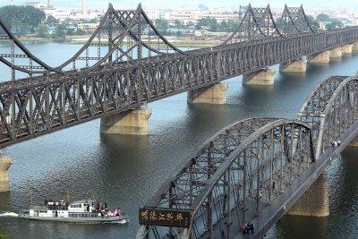 North Korea coal, air route, raise questions about sanctions